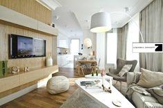 Nowoczesny apartament pokazowy zaprojektowany w skandynawskim duchu ma  powierzchnię 90 m2. Stonowana kolorystyka została dopełniona autorskimi obrazami Zuzanny Lesińskiej, które stanowią wyraźny akcent we wnętrzach. Drewno dębowe, biel oraz len i delikatne tkaniny stwarzają ciepły klimat a przemyśl