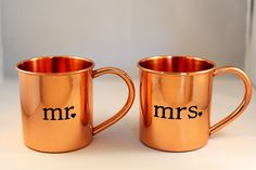 "There's not a more perfect wedding gift for Moscow Mule fans than a set of Mr. & Mrs. copper mugs! Each 14 oz mug is hand-crafted of pure copper and stamped with ""Mr."" and ""Mrs."" in two decorative font choices. These mugs are built to last, providing years of enjoyment as the happy couple grows t..."