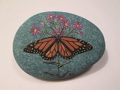 Monarch-Butterfly-and-Asters-hand-painted-on-a-rock-by-Ann-Kelly