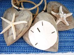 A locket of your love of the sea, this carved wood heart has a distressed finish on a rope hanger.  Attach a favorite shell.