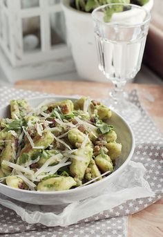 Polish gnocchi - kopytka with pesto, bacon and parmesan