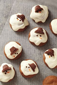 These melting snowman cookies are absolutely adorable! You'll love the easy cookie recipe and the kids will love decorating each treat with a chocolate candy hat, sprinkle nose, and chocolate chip eyes. #christmascookies #decoratedcookies #forkids #cuteholidaycookieideas #easy #bhg