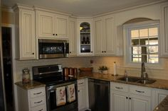 Beautiful Painted White with Brown Glaze Custom Cabinets.