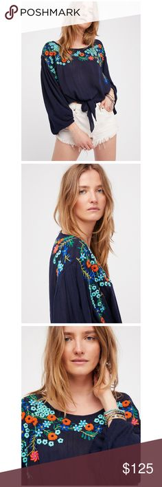 """Free People Embroidered Top Lightweight and semi-sheer top featuring beautiful floral embroidery.  Wide dolman style sleeves Cropped to the natural waist Tie detailing at the waist Elastic cuffs 100% Rayon Hand Wash Cold 🚫 NO TRADES Measurements for size Small Bust : 42"""" = 106.68 cm Length: 19"""" = 48.26 cm Sleeve Length: 21.5"""" = 54.61 cm Free People Tops"""