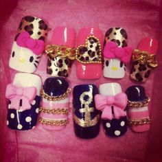 loving the black w/ white polka tips w/ bows! and the 1/2 pink, 1/2 leopard nail. CUTE! So me leopard,pink,gold and white hello kitty