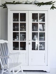 Christmas in Burgundy: At Home with the Expat Family Behind The Cook's Atelier (Remodelista: Sourcebook for the Considered Home) White China Cabinets, Painted China Cabinets, Dining Room Decor Elegant, Old Stone Houses, Glass Cabinet Doors, Glass Door, Buying A New Home, Decoration, Interior And Exterior