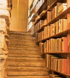 These bookshelves line stairs at the Fallingwater house designed by Frank Lloyd Wright.
