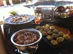 Poolside Southwest-themed appetizer buffet.