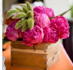 A wooden box provides a unique vessel for this very easy to make peony and millet centerpiece sent in by a real bride to the Knot.
