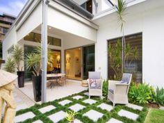 Indoor-outdoor outdoor living design with verandah & rockery using tiles - Outdoor Living Photo 351436