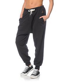 Crafted with a terry construction and a relaxed fit with a drop crotch, these black colored joggers are finished with faux leather patches and logo detailing throughout that will keep your style on point.