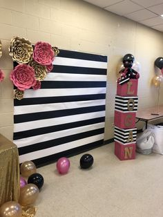 Black and white stripes backdrop Kate spade pink and gold flowers