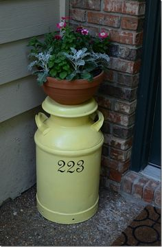 Milk can with address and planter.