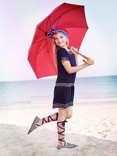 This photo could not be more adorable!     vintage swimsuit style girl umbrella beach