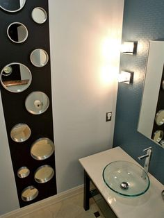 Look Up - If the floor space is limited, don't forget to look up! Make your bathroom seem larger by emphasizing the height of the room, like designer Shirry Dolgin did here with staggered mirrors.