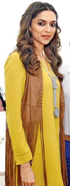 Deepika Padukone looking hot in a yellow dress.
