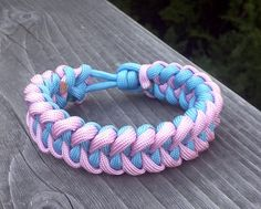 Baby blue and pink piranha paracord bracelet / loop clasp. I'll have my hubby make me one of these..