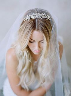 Lauren Conrad wore the Arielle Chignon Wrap by Jennifer Behr with a long, simple veil for her wedding day. Shop the look at www.jenniferbehr.com