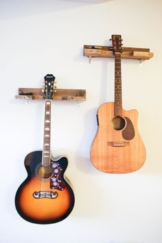 Lovely handcrafted, solid wood guitar rack made primarily out of old pallets. The wood has been washed and sanded for heath and safety purposes. This item can be customized as far as staining or paint finishes. Easy to install or if sold locally I can install it for you. Wall mounted.