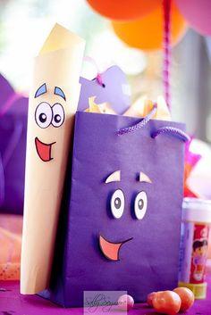Favor bags! Cute Dora themed decor.  Like the dancing stars on the cake