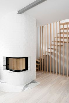 modern fireplace and detailed stairs in wood unique railing
