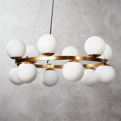 Shop Bubbles Brass Ring Pendant Light. Old Hollywood glam takes a flight of fancy in this stunning pendant light by Ceci Thompson. Bulbs floating off polished brass ring give off elevated vibes. Especially chic over a dining table. Learn about on our blog. CB2 exclusive.
