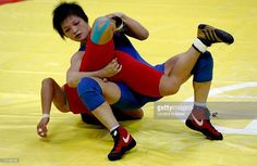 Chiharu Icho of Japan (blue) struggles with Kim Hyung Joo of Republic of Korea (South Korea)/ (red) in the Women's Freestyle 48kg Gold Medal Wrestling Competition during the 15th Asian Games Doha 2006 at the Aspire Hall on December11, 2006 in Doha, Qatar.