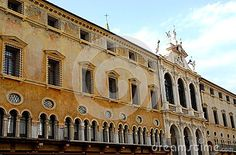 Photo taken at the north side of the square of the Lords in Vicenza in Veneto (Italy). In the image, taken from the side of the square near the cathedral, you can see the long façade of pawnshop, facing south. The historical building affects in particular the geometry of the building, on either side of the central part completely different from the wings, windows, different architectural structure depending on the floor, forming long lines.