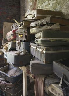 Old suitcases left behind in an abandoned children's asylum
