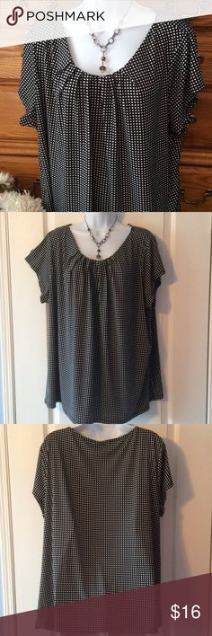 """Worthington Cute Black & White Top 95% polyester and 5% spandex.  Excellent condition and well made.  Has some stretch and really doesn't wrinkle.  Approximately 27"""" in length and when laid flat and measured from armpit to armpit it is 26"""" across.  Main color is black with little white squares all over it.   A little pleated just at the neckline to dress it up. Worthington Tops Tunics"""