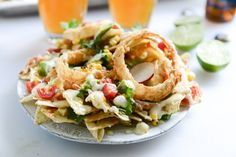 summer BBQ chicken nachos with buttermilk onion rings and white cheddar queso I howsweeteats.com