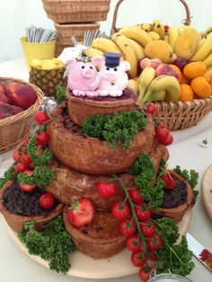 Wedding pork pie cake with fun pig cake toppers. Makes a great alternative to an evening buffet. #wedding