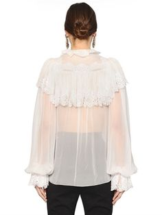 Ruffled collar and cuffs. Long puff sleeves. Front half snap button placket . Ruffled front and back shoulder panels. Lace trim and details . Sheer . Unlined . Sample size: 40