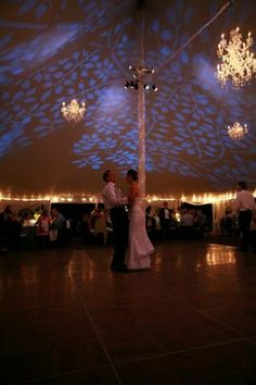 A clever mix of Gobo projected lighting mixed with classic glass chandeliers