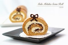 Gula Melaka Swiss Roll ~ Gula Melaka is rich in aroma and has beautiful caramel taste, therefore instead of using the usual caster sugar I used gula melaka in this swiss roll.