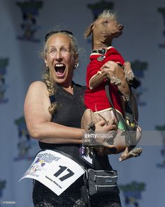 Rona Thau holds up Morris during the World's Ugliest Dog Competition in Petaluma, California on June 26, 2015. Quasi Modo went on to win first prize as the ugliest dog in the competition. AFP PHOTO/JOSH EDELSON