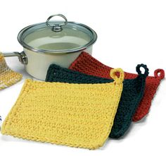 http://faythef.hubpages.com/hub/How-To-Knit-A-Potholder-Free-Patterns