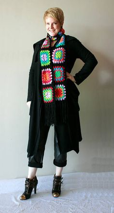 Image from http://www.crochetconcupiscence.com/wp-content/uploads/2012/04/crochet-granny-squares-scarf.jpg.