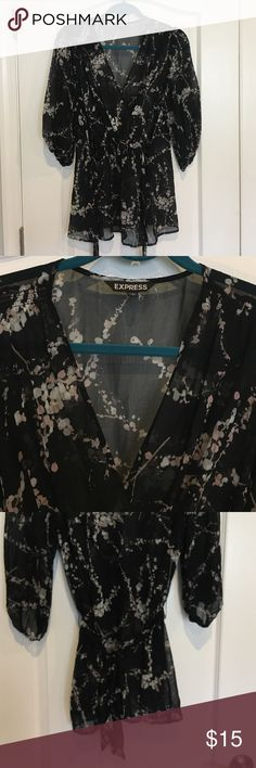 V NECK SHEAR BLOUSE Black with light pink grey flower design. Sheer so need to wear something under. Adjustable at waste with tie in back. From express size L Express Tops Blouses