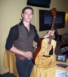 Drew Whelan with The EA Kroll Autographed Fender Guitar - 2012
