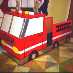 Cardboard + Duct tape = Firetruck for my son's birthday party!