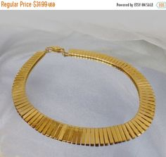 This #vintage gold fringe Egyptian Revival necklace is just gorgeous!  It features a mirror finish gold tone Egyptian Revival style choker necklace with wide flat graduated ... #ecochic #etsy #jewelry #jewellery