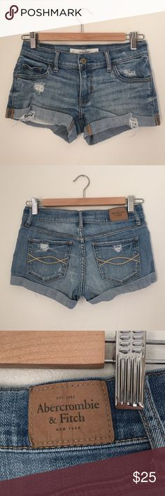 Abercrombie & Fitch Light Denim Destroyed Shorts These shorts have been worn twice max and are like brand new. Size is 0 and they fit wight 25. Abercrombie & Fitch Shorts Jean Shorts