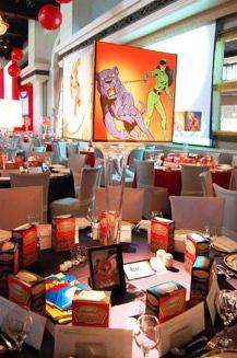 colorful centerpieces by placing images of original comic book characters in tall plexiglass boxes on stands.