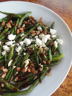 Blistered Green Bean Salad with Smoked Paprika Vinaigrette Feta Cheese and Chopped Almonds.