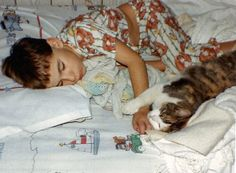 CAT MAN MONDAY: Adventure Writer James when he was just a young boy with his cat Mittens. His love of cats started at an early age. http://ihavecat.com/2014/02/24/cat-man-monday-adventure-writer/ #catman #catlover #cat