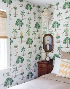 Tree-motif wallpaper in a guest room.