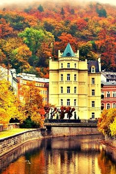 Karlovy Vary is a spa city in western Bohemia of the Czech Republic. It is historically famous for its hot springs, and also the city is home to the glass manufacturer Moser. River Teplá and beautiful colored houses Carlsbad, Czech Republic Places Around The World, Oh The Places You'll Go, Places To Travel, Places To Visit, Around The Worlds, Wonderful Places, Beautiful Places, Amazing Places, Les Continents