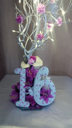 Sweet 16 Floral Centerpiece with LED Lights.  For info visit C&C Custom Creations on Facebook.