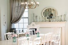 Love the mercury candle sticks on the mantel with an antique mirror